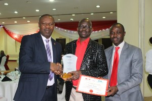 Dr. Rotimi Oladele, President, Nigerian Institute of Public Relations, NIPR (middle) presenting the Corporate Citizen Excellence Award won by SIFAX Group to the General Manager, Corporate Communication, Skyway Aviation Handling Company Limited, SAHCOL (left) and Mr. Olumuyiwa Akande, Corporate Affairs Manager, SIFAX Group, at the NIPR Presidential Dinner and Award ceremony held in Abuja.